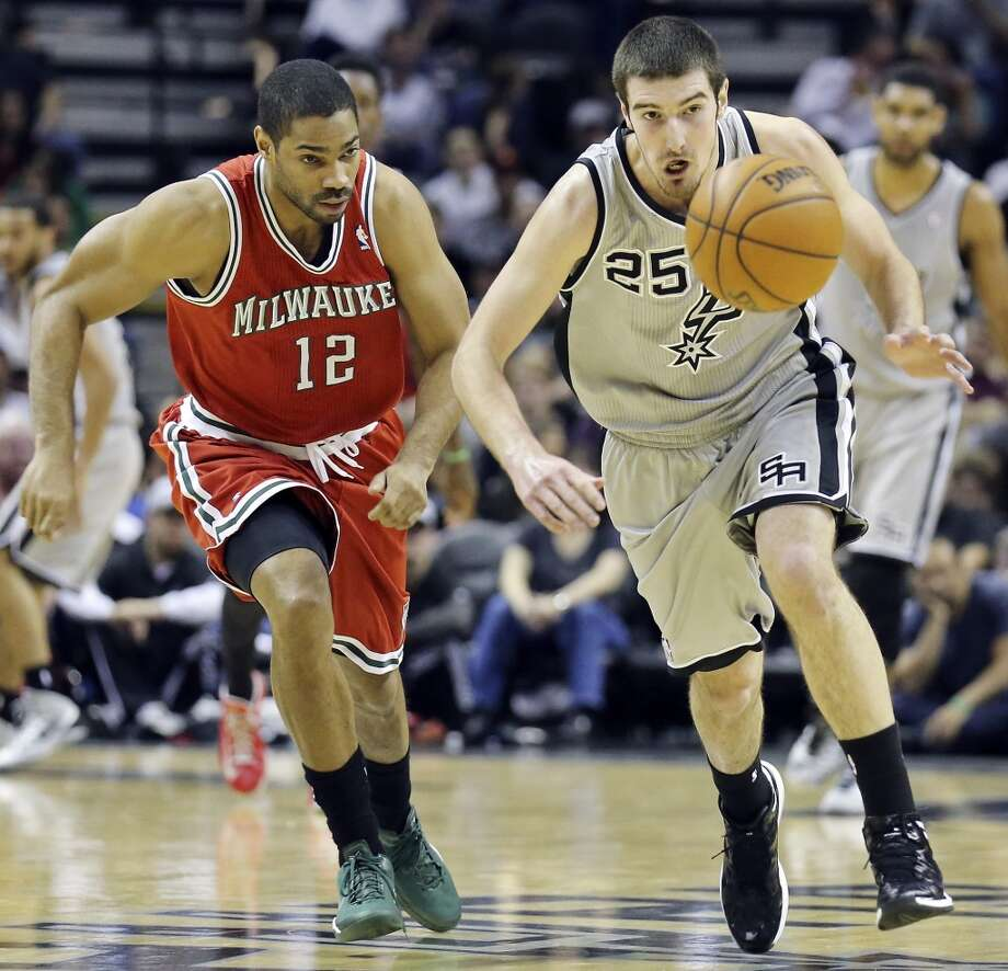 Nando De Colo,guard, averaged 4.2 points, 1.2 assists with Spurs this season; played for Spurs 2012-14. Traded to Raptors on Feb. 20, 2014. Averaged 3.4 points, 1.7 assists for his career Photo: Edward A. Ornelas, San Antonio Express-News