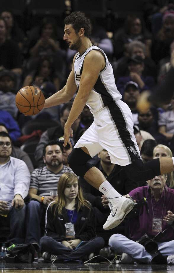 San Antonio Spurs' Marco Belinelli keeps the ball in play during the second half against the Utah Jazz at the AT&T Center, Wednesday, Jan. 15, 2014. The Spurs won 109-105. Photo: Jerry Lara, San Antonio Express-News