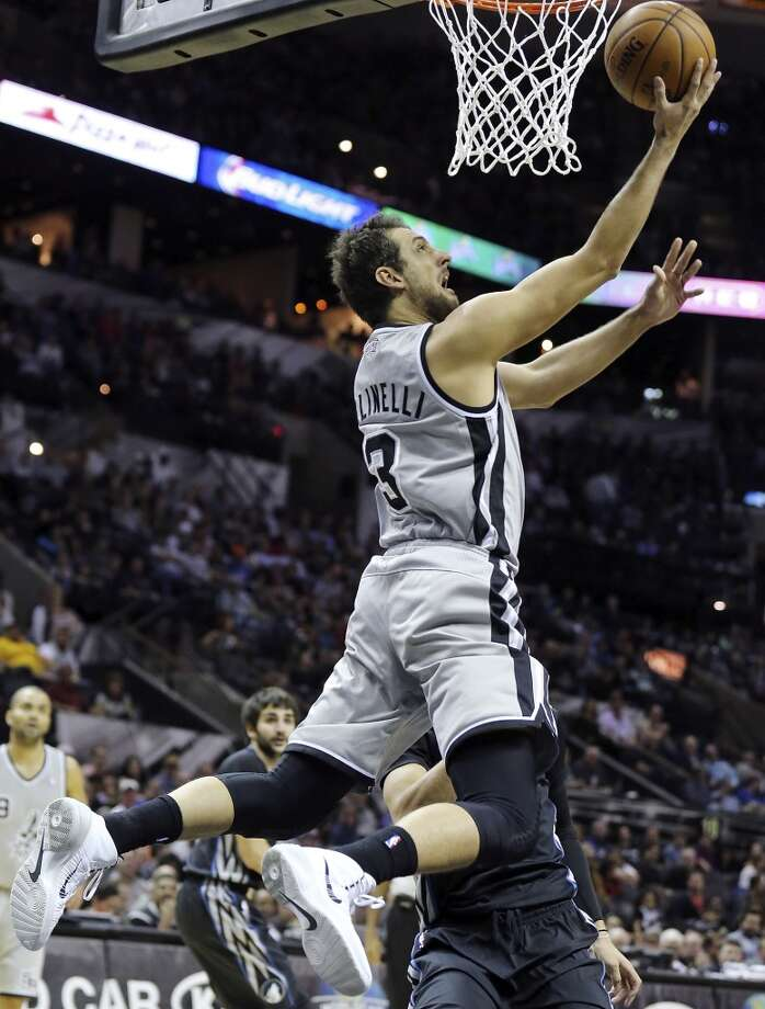 San Antonio Spurs' Marco Belinelli shoots against the Minnesota Timberwolves during first half action Sunday Jan. 12, 2014 at the AT&T Center. Photo: Edward A. Ornelas, San Antonio Express-News