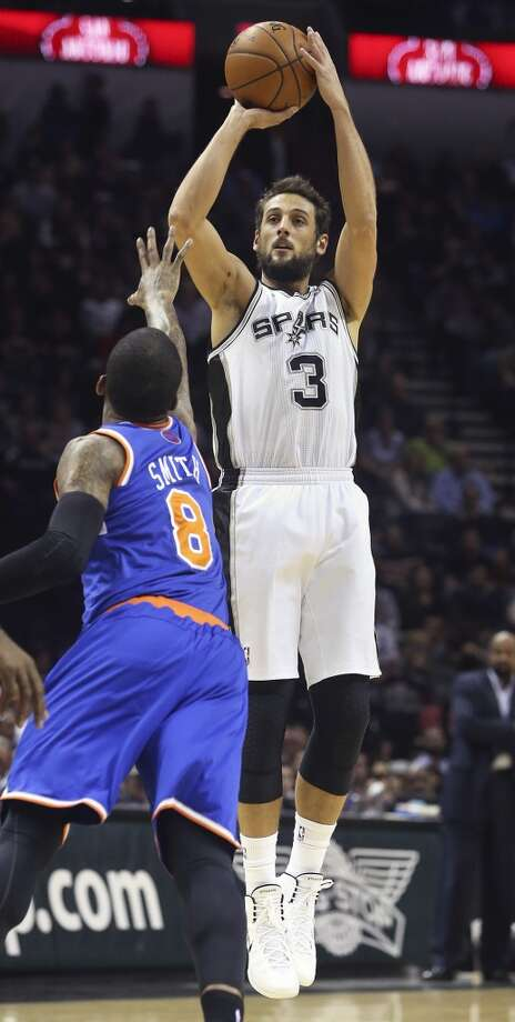 Marco Belinelli cranks in a three over J.R. Smith as the Spurs host the New York Knicks at the AT&T Center on January 2, 2014. Photo: Tom Reel, San Antonio Express-News
