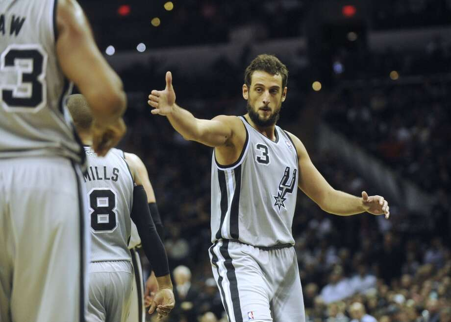 Marco Belinelli of the San Antonio Spurs encourages teammates during second-half NBA action at the AT&T Center on Saturday, Dec. 21, 2013. Oklahoma City won the game, 113-100. Photo: Billy Calzada, San Antonio Express-News