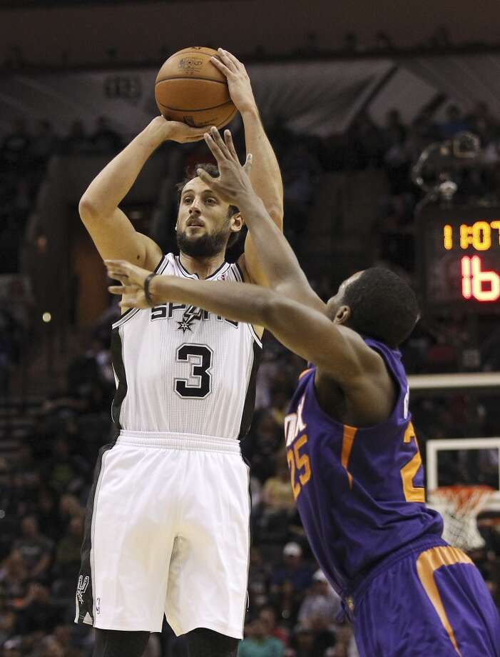 Spurs' Marco Belinelli (03) attempts a shot against Phoenix Suns' Dionte Christmas (25) at the AT&T Center on Wednesday, Nov. 6, 2013. Photo: Kin Man Hui, San Antonio Express-News