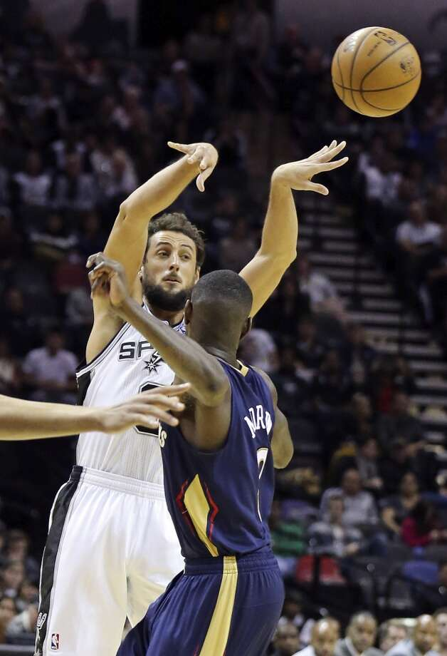 San Antonio Spurs' Marco Belinelli passes over New Orleans Pelicans' Anthony Morrow during second half action Monday Nov. 25, 2013 at the AT&T Center. The Spurs won 112-93. Photo: Edward A. Ornelas, San Antonio Express-News