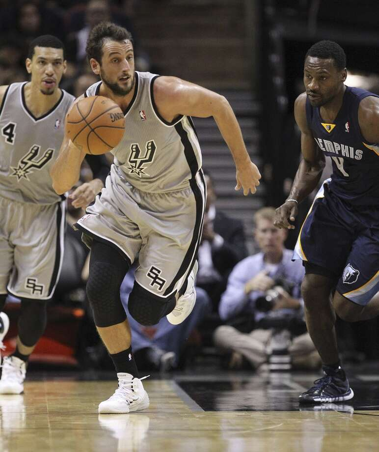 San Antonio Spurs' Marco Belinelli drives the ball as during the first half against the Memphis Grizzlies at the AT&T Center, Wednesday, Oct. 30, 2013. Photo: Jerry Lara, San Antonio Express-News