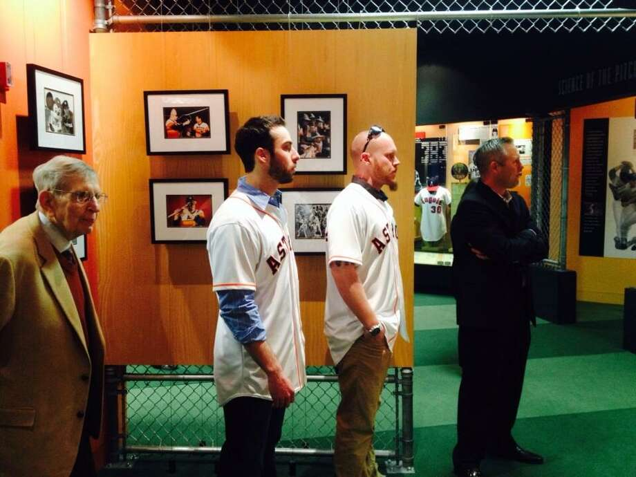 Reid Ryan shows Anthony Bass, Brett Oberholtzer and Milo Hamilton an exhibit at the Nolan Ryan museum. Photo: Jose De Jesus Ortiz, Houston Chronicle