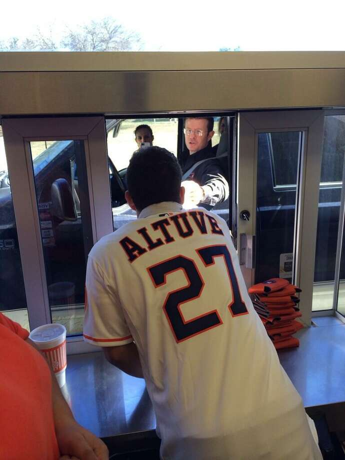 Jose Altuve working the drive through a  Whataburger in San Antonio. Photo: Jeff Luhnow, Houston Astros