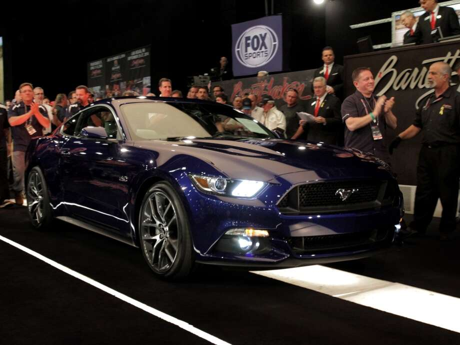 At Barrett-Jackson Auction Company'€™s sale in Scottsdale, Ariz., a car collector and North Texas Ford dealer, Sam Pack, paid $300,000 to have the first retail production unit of the all-new 2015 Mustang GT when it goes on sale this fall. This purchase helped Ford Motor Company increase its charity vehicle sales to more than $3.5 million for JDRF, the leading diabetes research organization and a Ford partner since 1983. Photo: Ford Motor Company