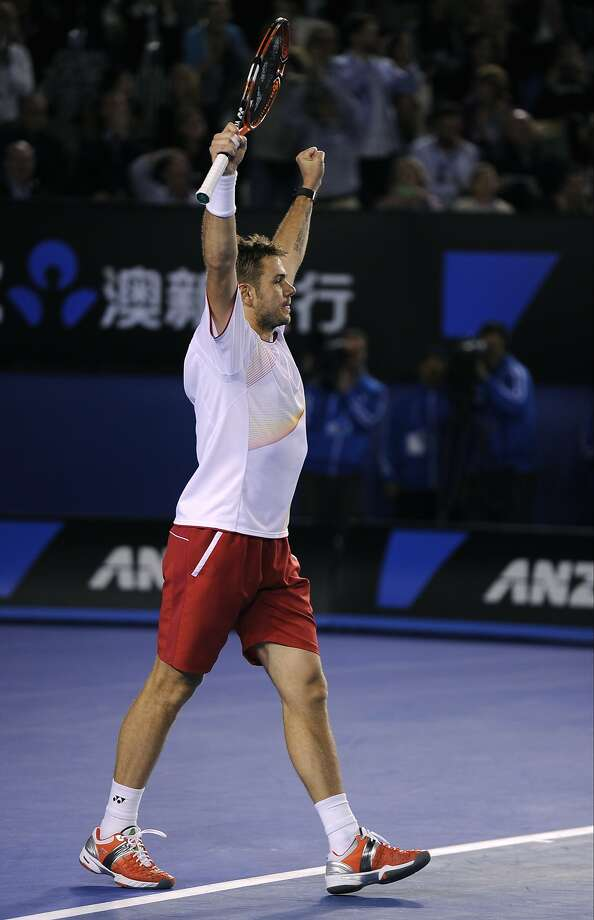 Stanislas Wawrinka celebrates after defeating Novak Djokovic in their four-hour, five-set quarterfinal match. Photo: Andrew Brownbill, Associated Press