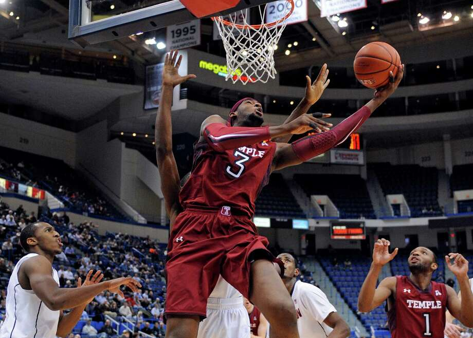 Temple's Anthony Lee (3) drives to the basket during the first half of an NCAA college basketball game against Connecticut, Tuesday. Jan. 21, 2014, in Hartford, Conn. (AP Photo/Fred Beckham) Photo: Fred Beckham, Associated Press / Associated Press