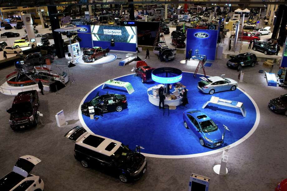 View of the Ford display preparing for the Houston Auto Show, Tuesday, Jan. 21, 2014, at Reliant Center in Houston. Photo: Marie D. De Jesus, Houston Chronicle / © 2014 Houston Chronicle