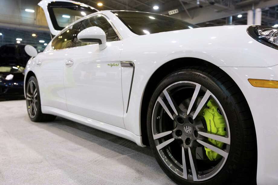 The fuel efficient Porsche Panamera S E-Hybrid can be run on gas, or by electric power and by both functioning together. The hybrid will be on display at the Houston Auto Show. Photo: Marie D. De Jesus, Houston Chronicle / © 2014 Houston Chronicle
