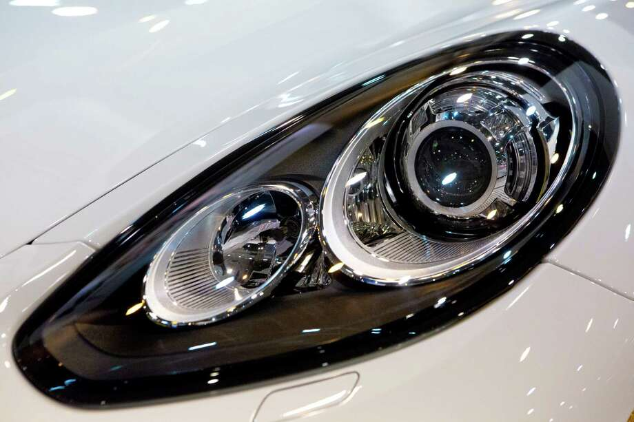 Porsche Panamera S E-Hybrid headlight. The Panamera   can be run on gas, or by electric power and by both functioning together. The hybrid will be on display at the Houston Auto Show Wednesday. Photo: Marie D. De Jesus, Houston Chronicle / © 2014 Houston Chronicle