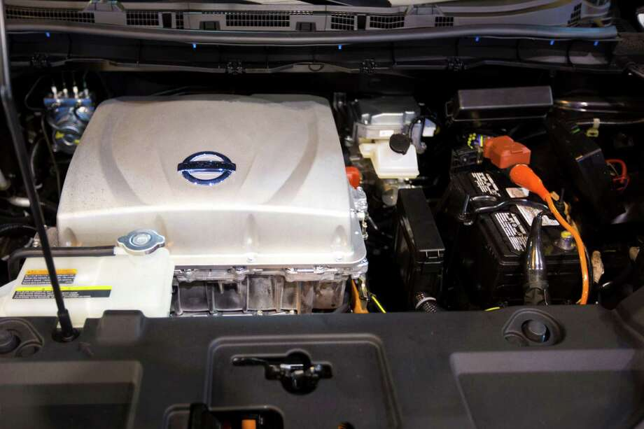 Under the hood view of the Nissan LEAF Electric Car in display at the Houston Auto Show, Tuesday, Jan. 21, 2014, in Houston. The Nissan LEAF gets the equivalent of about 129 miles per gallon in the city. Photo: Marie D. De Jesus, Houston Chronicle / © 2014 Houston Chronicle