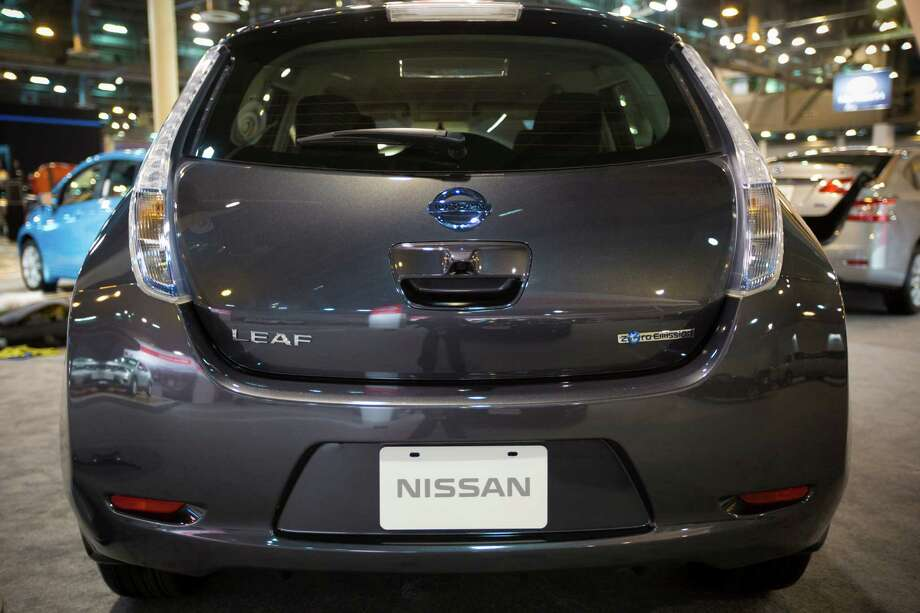 Back view of the Nissan LEAF which is an electric powered compact car. The LEAF is on display at the Houston Auto Show, Tuesday, Jan. 21, 2014, in Houston. Photo: Marie D. De Jesus, Houston Chronicle / © 2014 Houston Chronicle