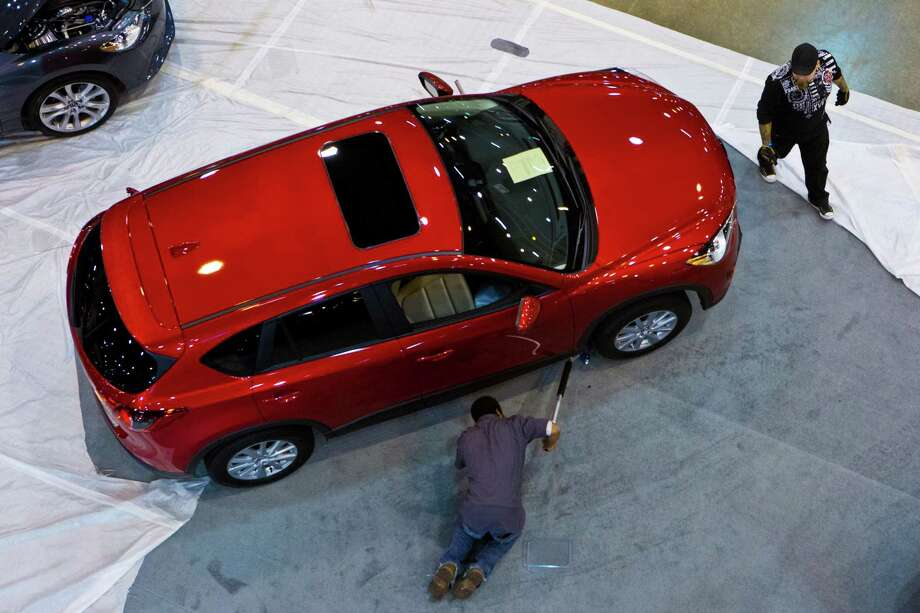 The last details are finished at the Mazda display located at Reliant Center for the Houston Auto Show, Tuesday, Jan. 21, 2014. Photo: Marie D. De Jesus, Houston Chronicle / © 2014 Houston Chronicle