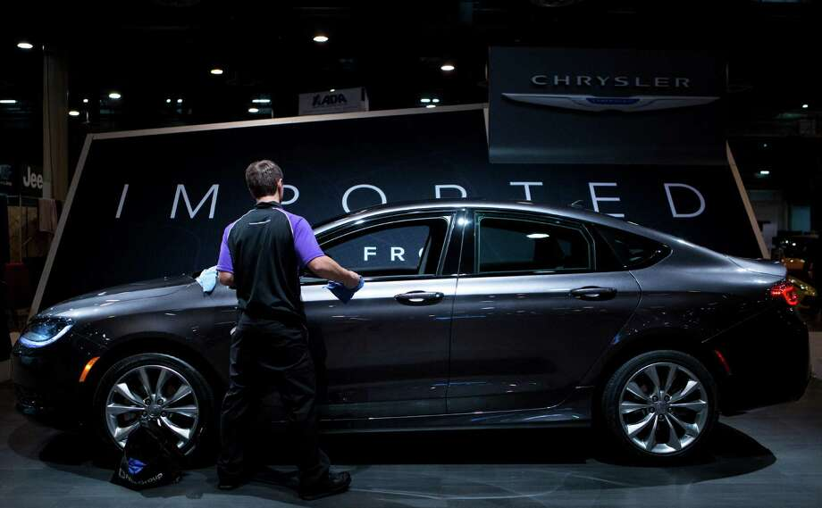 The new Chrysler 200 mid-size sedan is finished up for the Houston Auto Show, Tuesday, Jan. 21, 2014, in Houston. Chrysler 200 has a modern sleek design taking a special place at the auto show. Photo: Marie D. De Jesus, Houston Chronicle / © 2014 Houston Chronicle