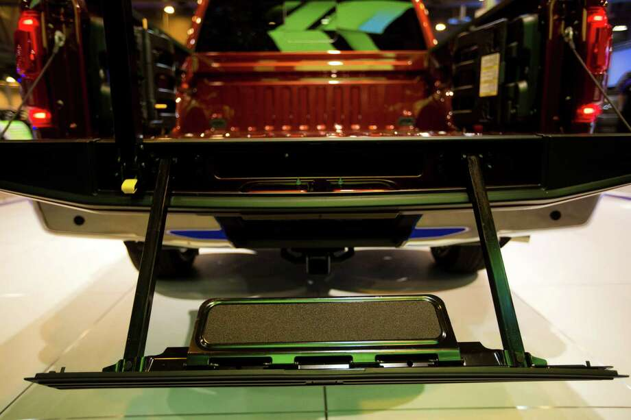 Ford F-150 pick-up truck comes with a step and grab bar which can be folded and put away in the tailgate. Tuesday, Jan. 21, 2014, in Houston. Photo: Marie D. De Jesus, Houston Chronicle / © 2014 Houston Chronicle