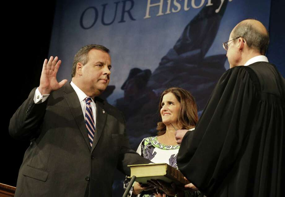 With wife Mary Pat Christie holding the Bible, Gov. Chris Christie is sworn in for his second term by N.J. Supreme Court Chief Justice Stuart Rabner. Photo: Mel Evans / Associated Press / AP