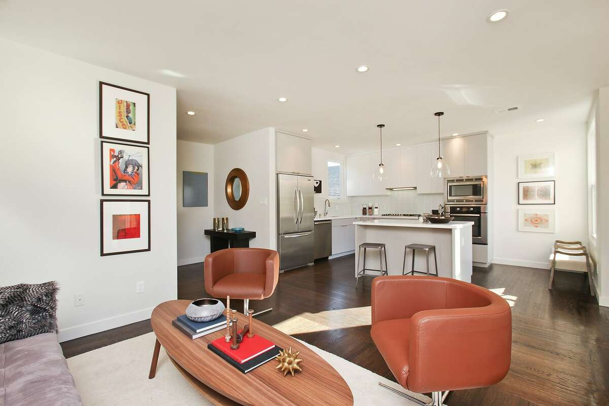 The eat-in kitchen includes Caesarstone counters, Bosch appliances and porcelain tile.