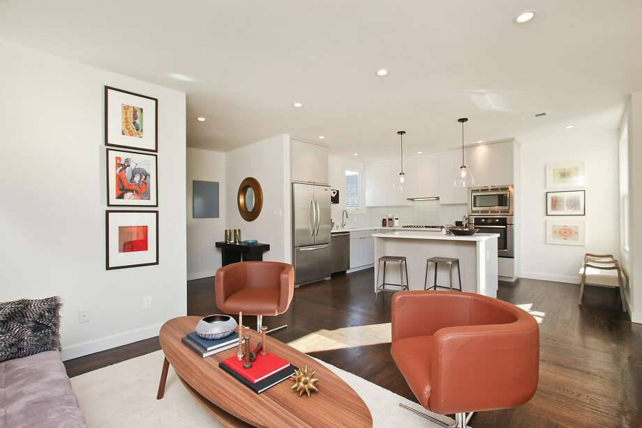The eat-in kitchen includes Caesarstone counters, Bosch appliances and porcelain tile. Photo: OpenHomesPhotography.com