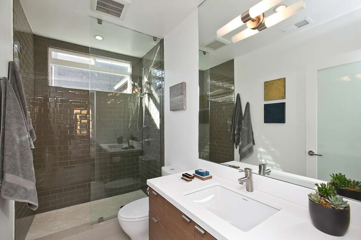 The master bathroom includes a glass and tile shower.