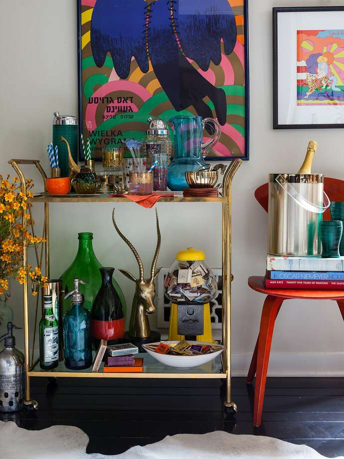 A vintage bar cart comes to life with an eclectic mix of colorful glassware and accessories. Photo: Hunters Alley