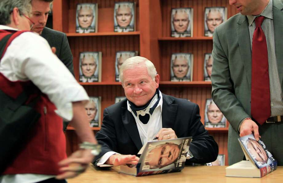 Former Secretary of Defense Robert Gates signs his best-selling book 'Duty: Memoirs of a Secretary at War' at Barnes & Noble River Oaks on Tuesday, Jan. 21, 2014, in Houston. Photo: Mayra Beltran, Houston Chronicle / © 2013 Houston Chronicle