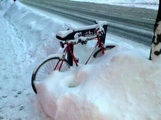 """Martin Hatcher took this shot of an overwhelmed bicycle on Lark Street in Albany after  the first big snowfall of the year. """"I had been feeling a bit sorry for myself having dug out the driveway three or four times after being plowed in until I saw the bike buried and I had to laugh,"""" he said. (Martin Hatcher)"""