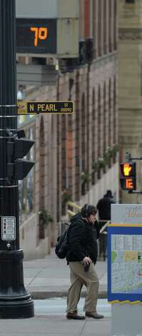 A pedestrian walks under the single digit temperature on the bank building thermometer at the corner of State Street and North Pearl Street Tuesday morning Jan. 21, 2014 in Albany, N.Y.         (Skip Dickstein / Times Union) Photo: SKIP DICKSTEIN / 0025443A