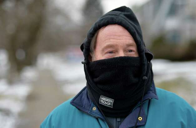 Rick Carson, out for his daily walk uses a scarf to protect his face from the extreme cold on Euclid Street Tuesday afternoon Jan. 21, 2014 in Albany, N.Y.  (Skip Dickstein / Times Union) Photo: SKIP DICKSTEIN / 0025443A