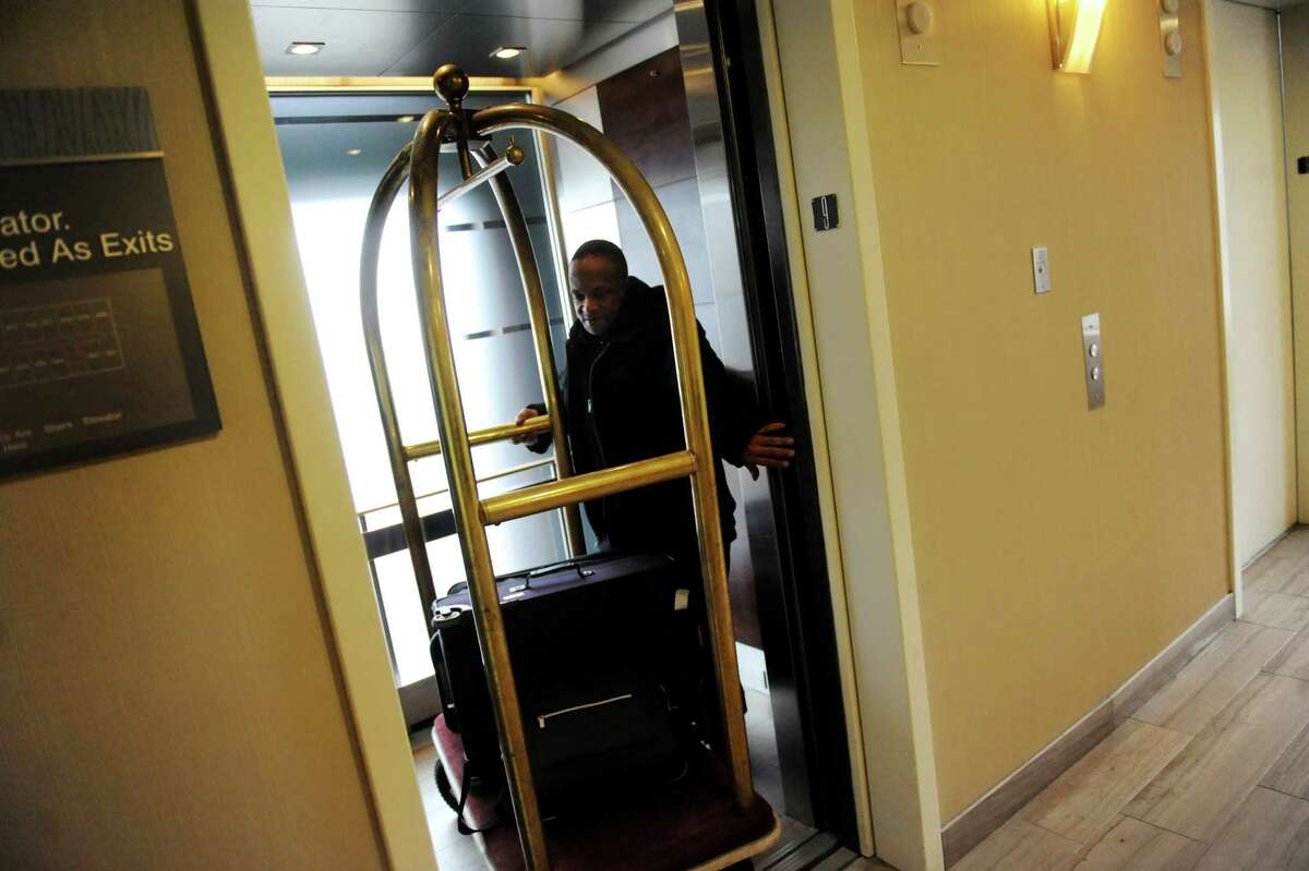 A bellman exits the elevator with a luggage cart on Tuesday, Jan. 21, 2014, at the Hilton Albany in Albany, N.Y. (Cindy Schultz / Times Union)
