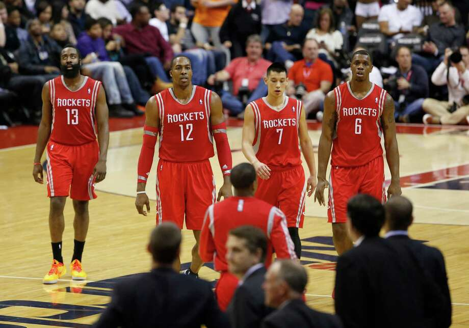 The Rockets' floor leader? Well, guard James Harden, from left, center Dwight Howard, guard Jeremy Lin and forward Terrence Jones walk shoulder to shoulder with no one stepping up as the take-charge guy when the team needs a collective kick in the shorts. Photo: Alex Brandon, STF / AP