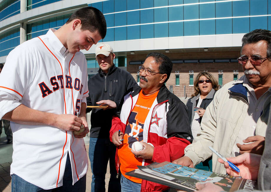 Pitcher Mark Appel, the No. 1 overall pick in the 2013 draft, signs autographs for fans during the Astros' winter caravan stop Tuesday in front of the Alamodome. Photo: Marvin Pfeiffer/ Express-News / Express-News 2013
