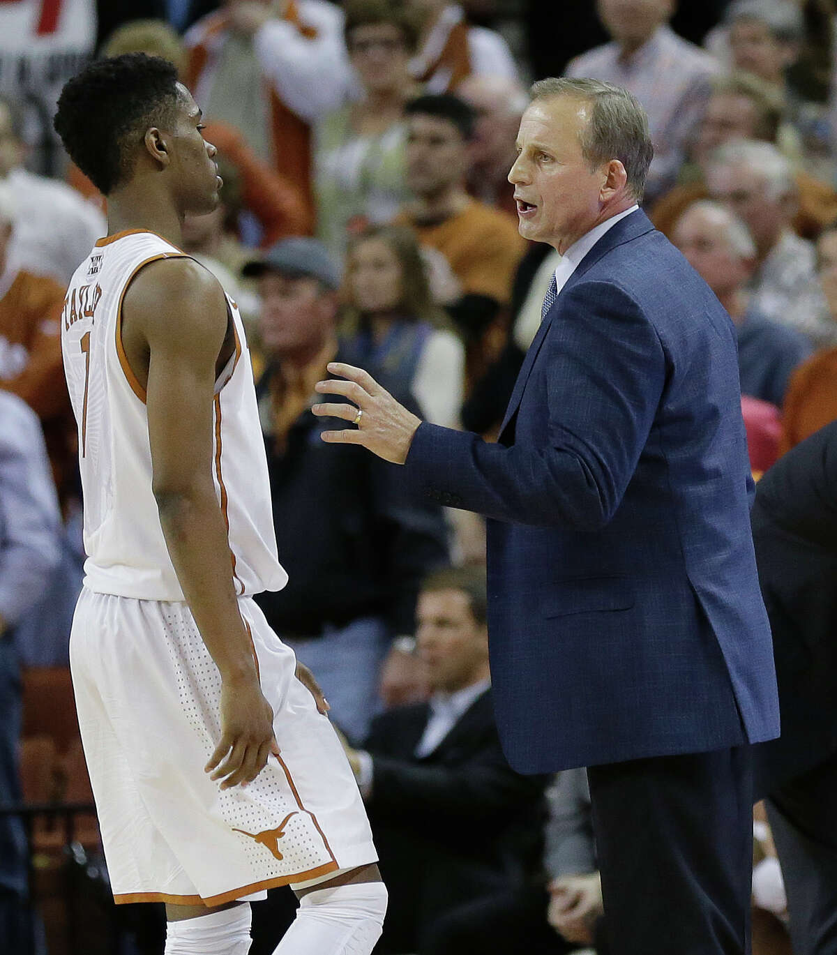 Texas coach Rick Barnes, right, talks with Isaiah Taylor (1) during the second half of a NCAA college basketball game against Kansas State, Tuesday, Jan. 21, 2014, in Austin, Texas. Texas won 67-64. (AP Photo/Eric Gay)