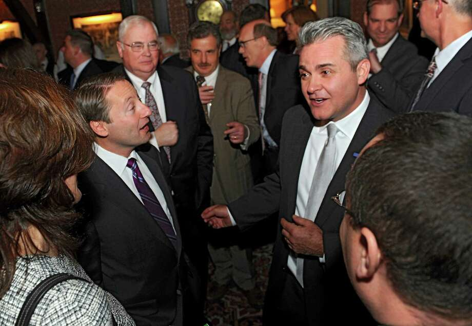 Westchester County Executive Rob Astorino, second from left, mingles with people including Assemblyman Steve McLaughlin, second from right, during the NYS GOP's Rising Stars fundraiser at the Fort Orange Club Tuesday, Jan. 21, 2014 in Albany, N.Y. (Lori Van Buren / Times Union) Photo: Lori Van Buren / 00025455A