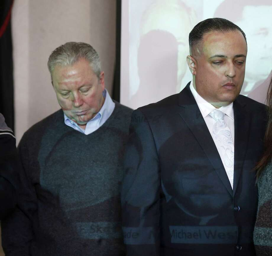 Joe Iacono (left) and Angel Santiago, both abused sexually by priests, listen during a news conference on the release of the personnel files of Catholic priests credibly accused of sexually abusing children in the Archdiocese of Chicago. Photo: Charles Rex Arbogast / Associated Press / AP