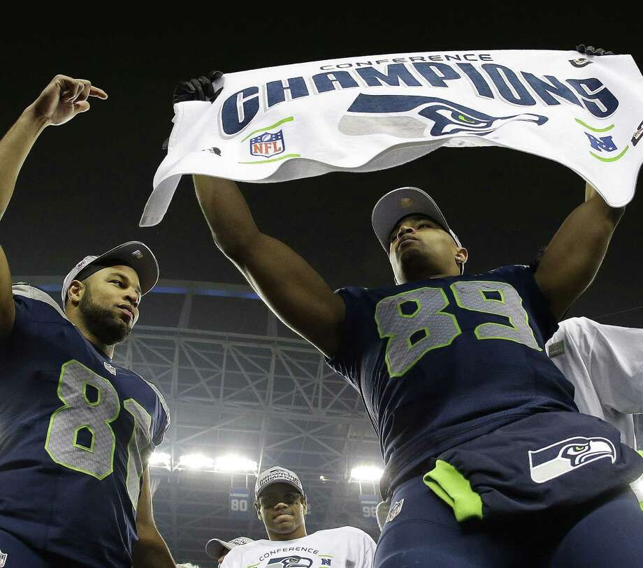 Two of the Seahawks' unheralded receivers, Doug Baldwin (right) and Golden Tate, celebrate Seattle's NFC championship victory over the 49ers. Baldwin had six catches for 106 yards, including a 51-yarder, and Tate had four receptions. Photo: Matt Slocum / Associated Press / AP