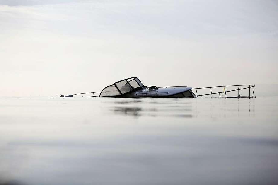 A derelict boat lies partially submerged south of Candlestick Point State Recreation Area on January 21, 2014 in San Francisco, Calif. Officials said the boat has been there for about a month and that removing the wreck is a difficult proposition involving numerous jurisdictions. Photo: Pete Kiehart, The Chronicle