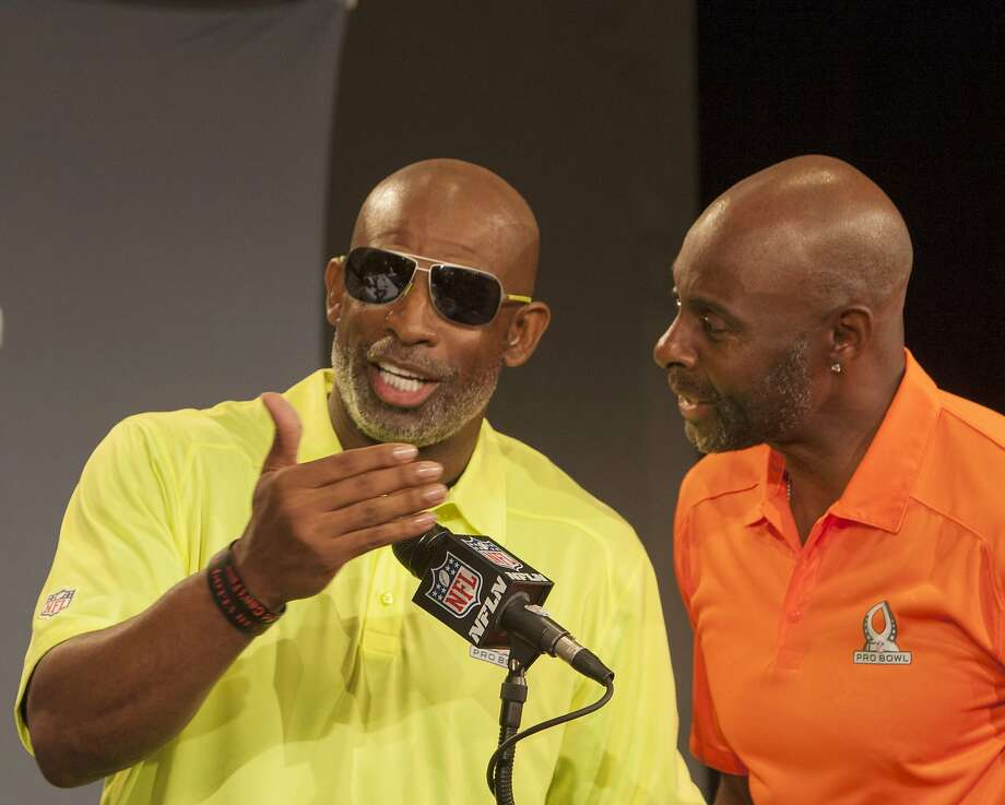 Hall of Famers Deion Sanders (left) and Jerry Rice, the Pro Bowl captains, trade jibes at a news conference in Hawaii. Photo: Marco Garcia, Associated Press
