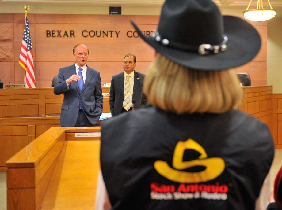 "Bexar Country Judge Nelson Wolff (left) comments on the San Antonio Stock Show and Rodeo as its Ambassadors Chairperson Cindy Gidden (foreground) and Commissioner Sergio ""Chico"" Rodriguez listen. Photo: Robin Jerstad / For The Exress-News"