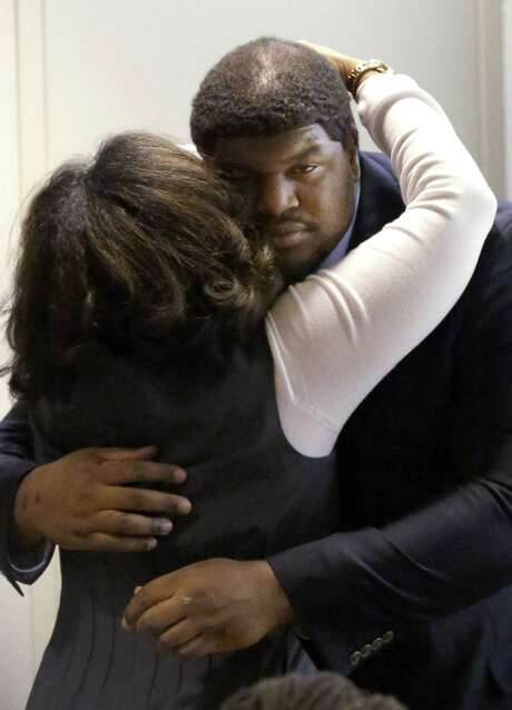 Josh Brent hugs a family member after closing arguments in his intoxication manslaughter trial in Dallas. Photo: LM Otero / Associated Press / AP