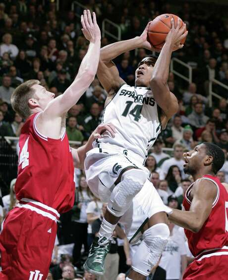 Michigan State's Gary Harris puts up a shot between Indiana's Jeff Howard (left) and Evan Gordon. Harris finished with 24 points. Photo: Al Goldis / Associated Press / FR11125 AP
