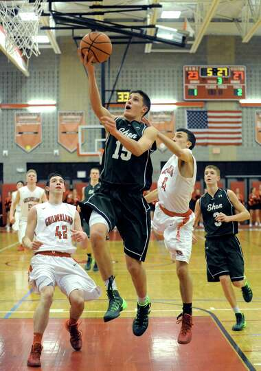 Shen's Thomas Huerter goes in for a score during their boy's high school game against Guilderland on