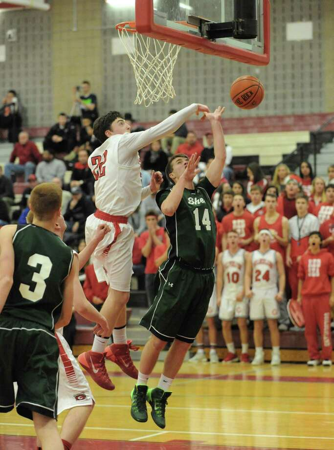 Guilderland's Andrew Platek defends a shot from Shen's Troy Farkas during their boy's high school game on Tuesday Jan. 21, 2014 in Guilderland, N.Y.  (Michael P. Farrell/Times Union) Photo: Michael P. Farrell / 00025441A