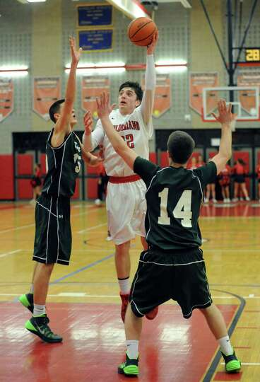 Guilderland's Andrew Platek goes in for a score during their boy's high school game against Shenende