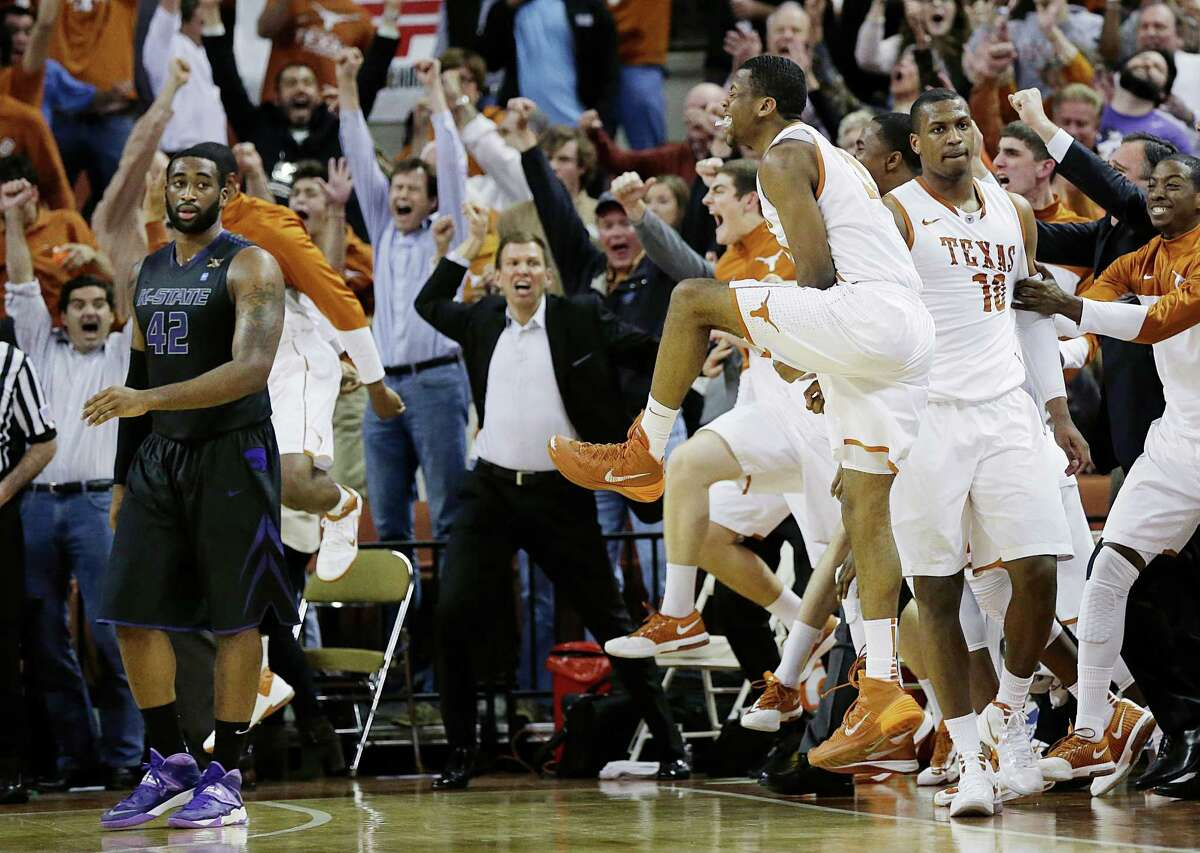 Jonathan Holmes (10) takes it all in stride as his UT teammates and the Longhorns' fans go crazy after Holmes' buzzer-beater.