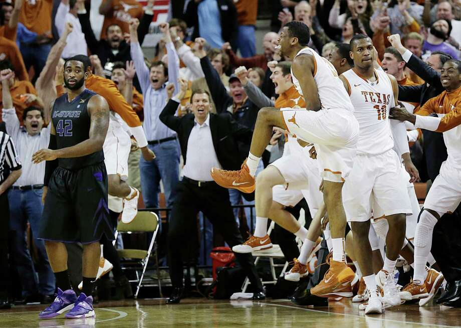Jonathan Holmes (10) takes it all in stride as his UT teammates and the Longhorns' fans go crazy after Holmes' buzzer-beater. Photo: Eric Gay, STF / AP