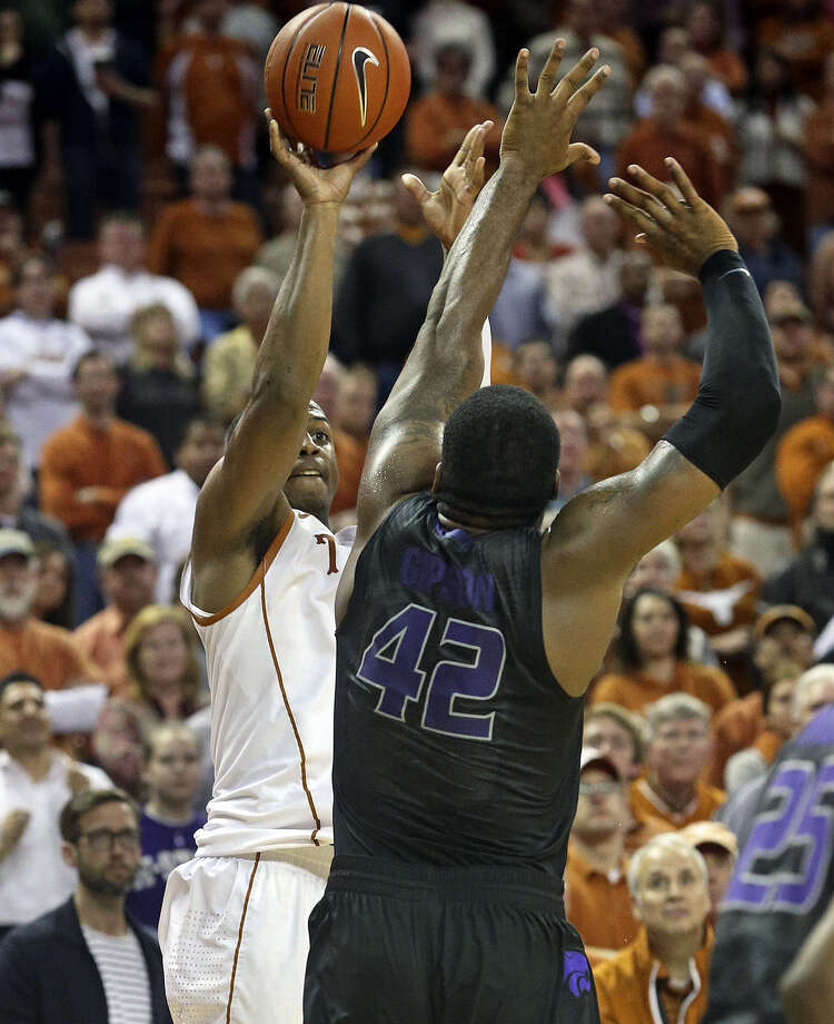 UT's Jonathan Holmes launches the game-winning 3-pointer over Kansas State's Thomas Gipson in Austin. The Antonian product shot only 3 of 8, finishing with eight points and 10 rebounds. Photo: Tom Reel / San Antonio Express-News