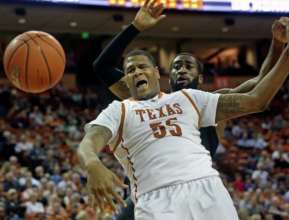 Longhorn center Cameron Ridley gets fouled over the back by Thomas Gipson as UT hosts Kansas State at the Erwin Center in Austin on January 21, 2014. Photo: For The San Antonio Express-News