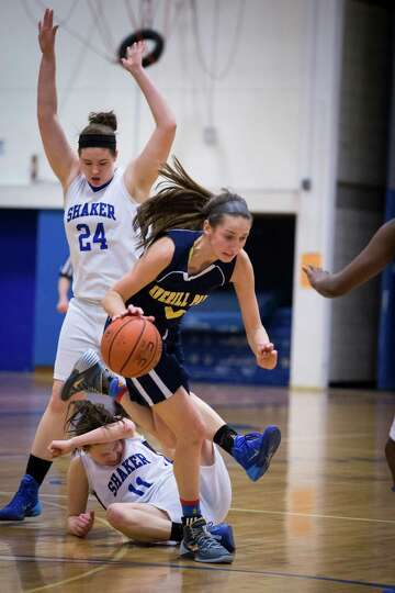 Averill Park's #5 Kelly Donnelly wins possession of a loose ball over Shaker's #11 Jenni Barra and #